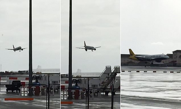 Rocked in Gibraltar! Extraordinary footage shows passenger plane being tipped violently