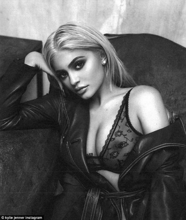 Busty babe! Kylie Jennerleft little to the imagination as in a sheer black lace bra as she promoted her upcoming pop-up shop