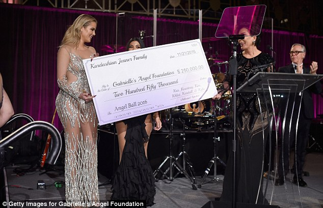 Donation: Khloe and Kourtney presented a cheque for $250,000 to the foundation from the Kardashian and Jenner family