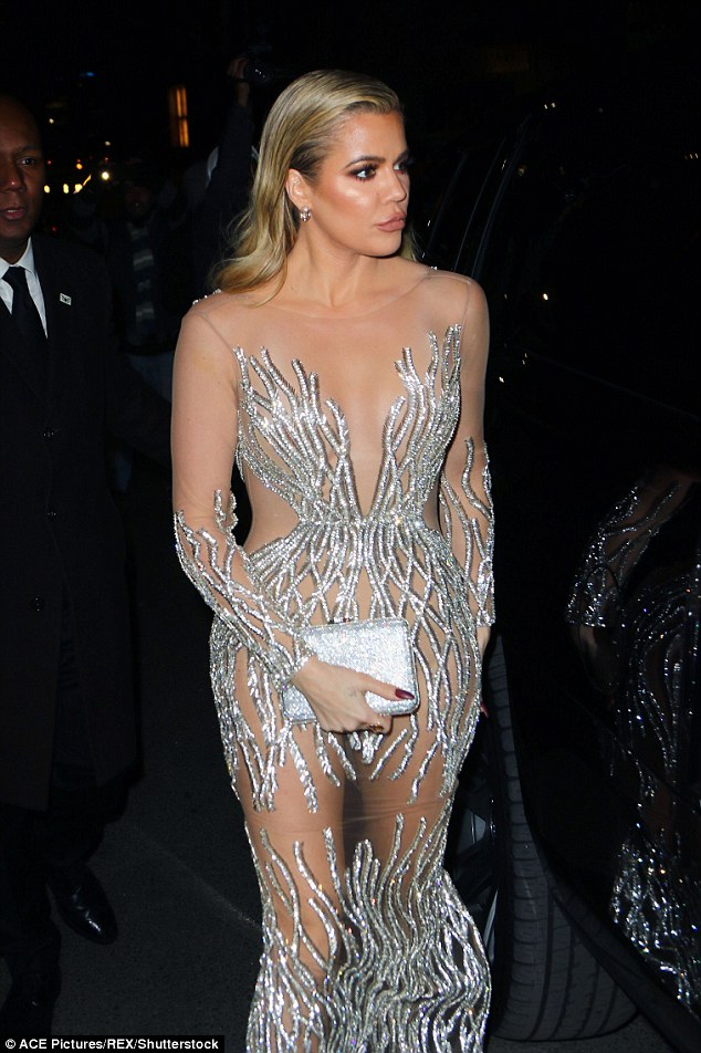 Calling it a night: Khloe let her dress and Judith Leiber clutch do the talking as she headed home