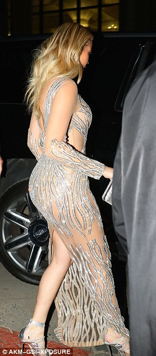Stunning: Khloe showed off every inch of her gym-honed figure in her glittery dress