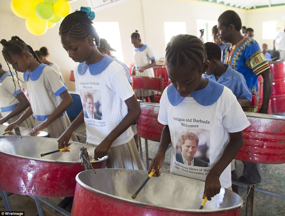 The school children wear t-shirts with Prince Harry's face on which say 'Antigua and Barbuda Welcomes HRH Prince Henry of Wales 20th-22nd November, 2016'