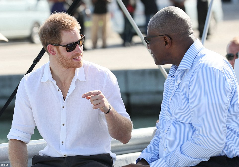 The prince chatted to island dignitaries as he headed out to the mangroves on the whistle-stop tour