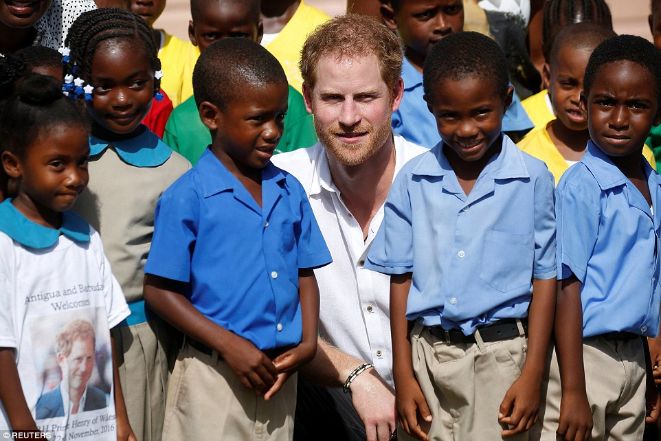 Harry looked flushed in the warm morning sun; Barbuda can expect highs of 29 degrees - a far cry from UK weather