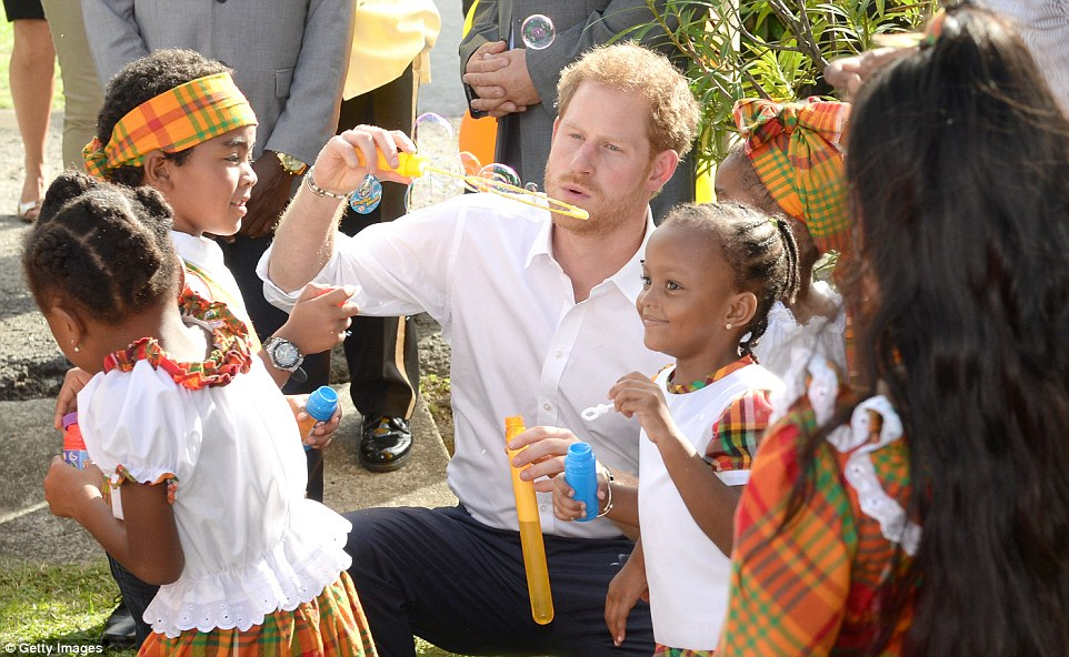 Enterainment: The prince also had fun blowing bubbles with youngsters in national dress, who were entertained by clowns and stilt-walkers
