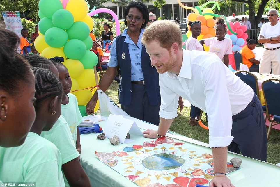 Prince Harry (pictured) was visiting Antigua and was happy to talk to children who gathered for the event in the capital