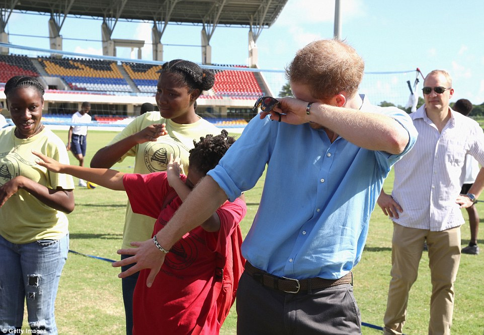 Harry 'hits the dab', performing the popular dance move with young students in Antigua at the start of his 15-day tour of the Caribbean. He looked more comfortable here than later in the evening