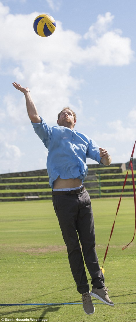 Ready to impress: The sporty royal showed off his midriff as he launched himself at the ball during a volleyball match