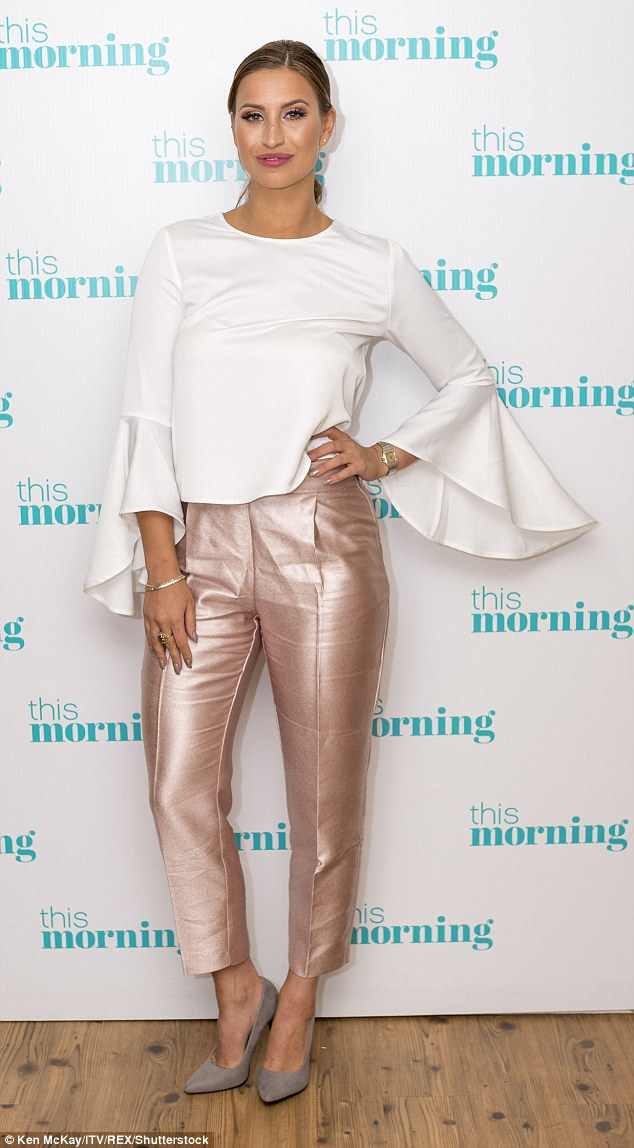 Fashionista: On Tuesday morning's appearance, Ferne looked sartorially savvy in rose gold satin trousers and stylish white blouse