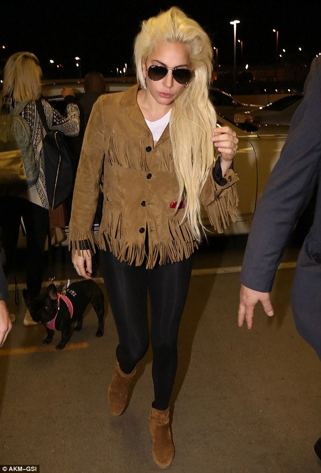 It's a dog's life: Lady Gaga looked tired as she got ready to jet out of LA on Monday