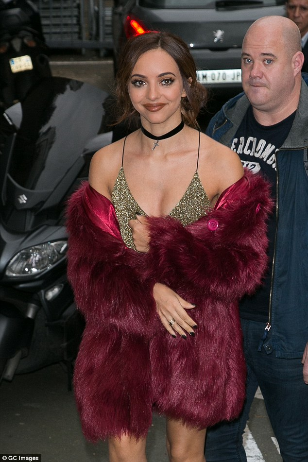 Jade Fur-wall: Little Mix singer steals the limelight from bandmates in tiny gold dress and luscious red fur coat as she arrives for radio interview in Paris