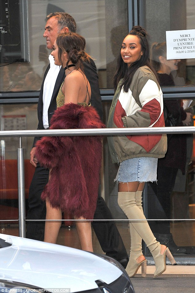 On trend: She strutted happily along, behind her fellow Little Mix bandmates, in killer black strappy heels as she teetered from her car to the steps of the studios, smiling and waving at fans