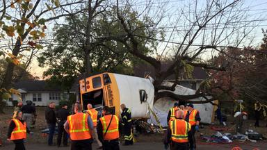 rescue offials at the scene of a school bus crash involving several fatalities in chattanooga