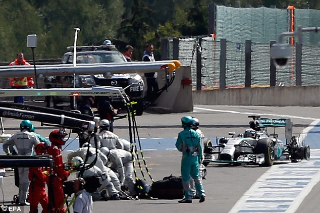Collision: Hamilton suffered a puncture before he  retired, falling further behind Rosberg in the F1 title race