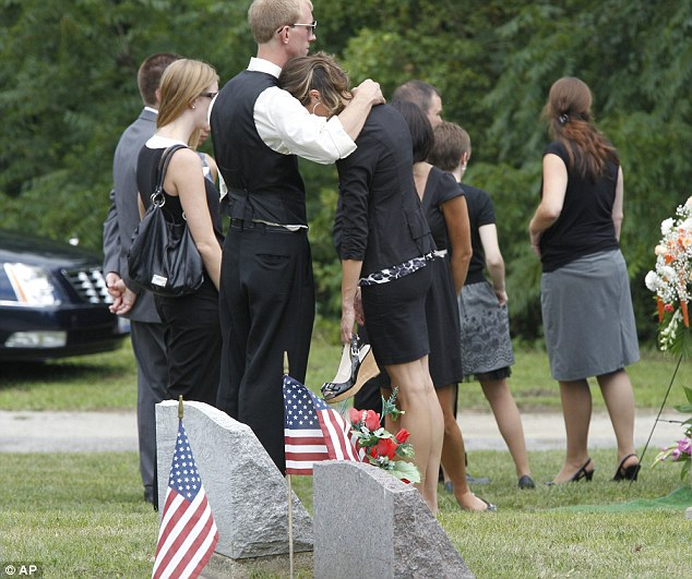 Tears: Relatives and friends of victim Matt McQuinn mourn at the cemetery after his funeral on Saturday