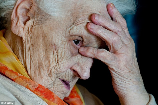 An elderly woman suffering from Alzheimer's disease in a residential home specialising in the care of people with dementia