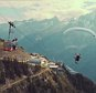 WATCH THIS NUTJOB PARAGLIDE INTO A MOVING CABLE CAR11.jpg