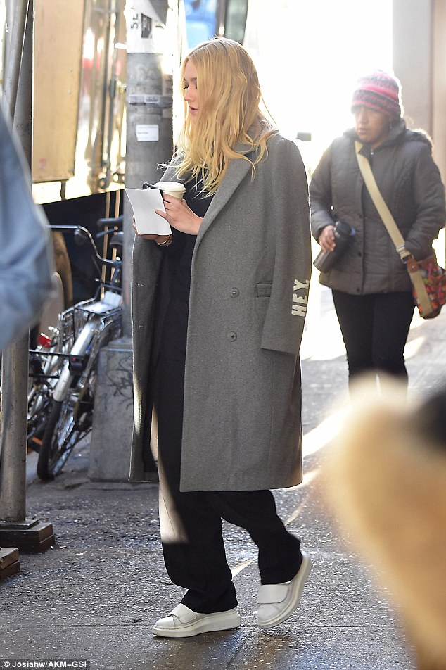 All-star: The latest star to be seen on the set of Ocean's 11 spin-off Ocean's 8 is Dakota Fanning, with the actress pictured filming in New York on Wednesday