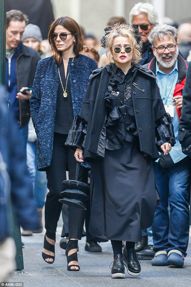 Gothic-tinged: The Fight Club actress sported wild hair with a circular pair of shades and bold red lips