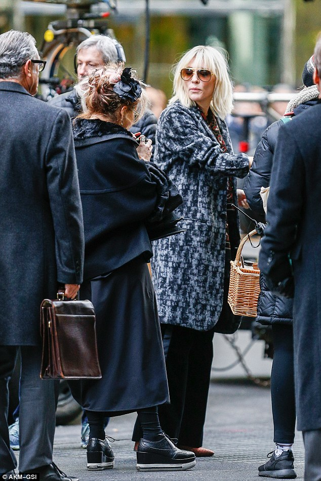 In character: Cate sported a knee-length monochrome coat and shoulder-length blonde locks