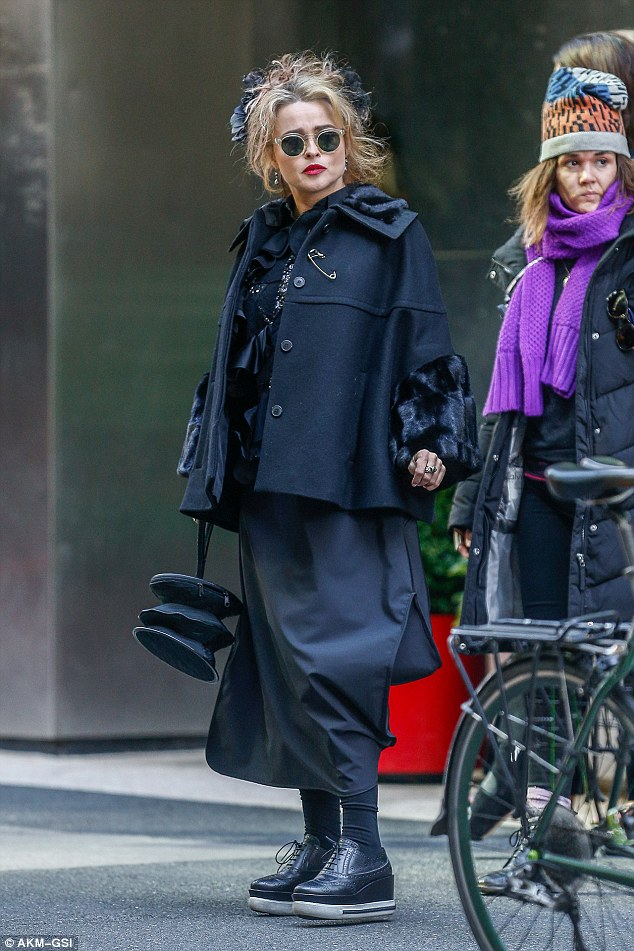 Eccentric: Helena Bonham Carter, 50, was pictured in costume for the first time since filming began on Monday, and she looks to be playing a trademark quirky character