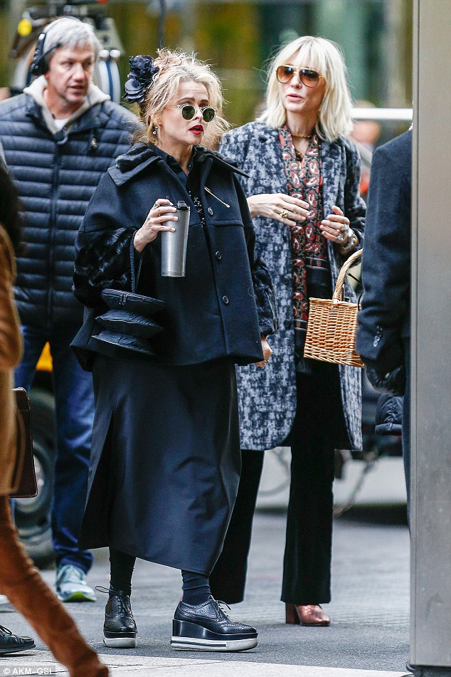 Standing out from the crowd: The English star kept things coordinated with a frilly shirt, long skirt and platform brogues, while she carried an unusual handbag