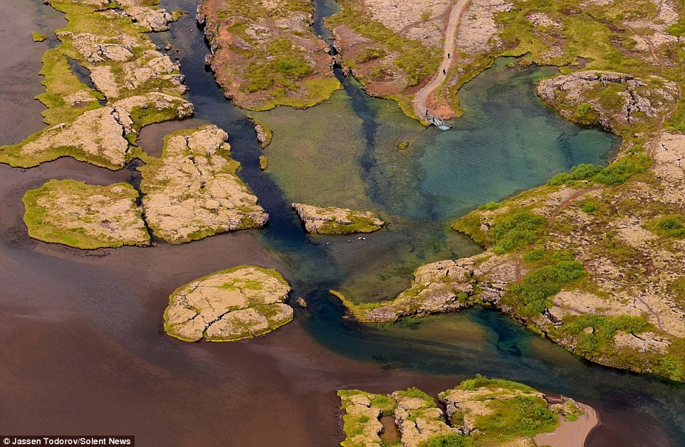 The splits in the land, which has many faults, valleys, volcanoes and hot springs, are caused by the Eurasian and North American plates in Iceland pulling apart