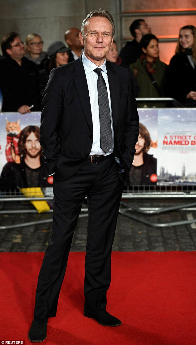 Cat got your tongue? Anthony Head - who plays Alex's father in the flick let out a coy smile as he posed on the red carpet in a black suit and tie