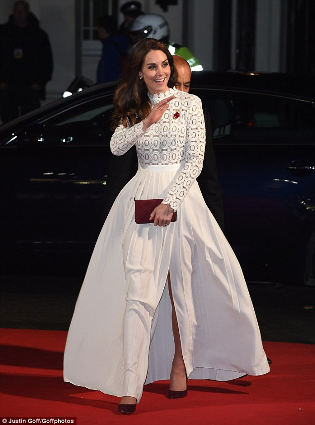 Fit for a purrincess: The Duchess Of Cambridge dazzled in a cream full skirted gown with a lace long-sleeved top whilst she injected some colour with burgundy heels and a clutch