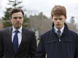 "This image released by Roadside Attractions and Amazon Studios shows Lucas Hedges, right, and Casey Affleck in a scene from ""Manchester By The Sea."" The film has been named best film by the National Board of Review, which lavished four awards on Kenneth Lonergan¿s New England portrait of grief. In awards announced Tuesday by the National Board of Review, ¿Manchester by the Sea¿ also took best actor for Casey Affleck¿s lead performance, best screenplay for Lonergan¿s script and best supporting actor for the breakout performance by Lucas Hedges. (Claire Folger/Roadside Attractions and Amazon Studios via AP)"