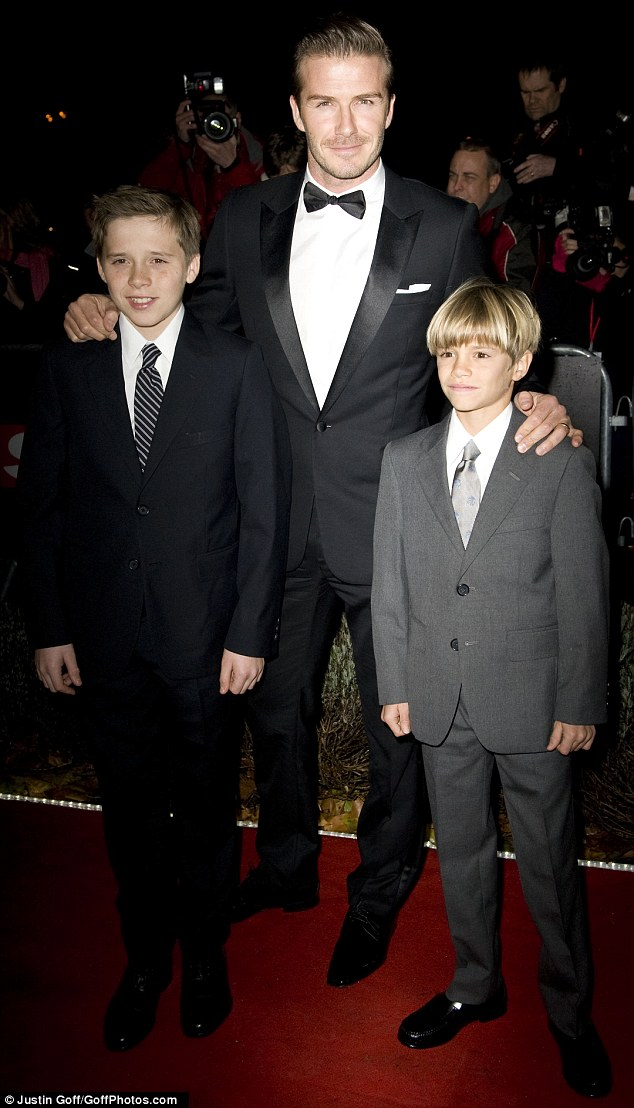 Proud father: David Beckham poses with Brooklyn and Romeo at The Sun Military Awards in London