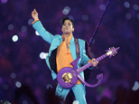 FILE - In this Feb. 4, 2007, file photo, Prince performs during the halftime show at the Super Bowl XLI NFL football game at Dolphin Stadium in Miami. A new court filing suggests that Prince's estate is worth about $200 million. It's the first time a specific estimate has emerged publicly from court proceedings following Prince's overdose death in April 2016. (AP Photo/Chris O'Meara, File)