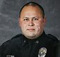 "This undated photo provided by the Tacoma Police Department shows officer Reginald ""Jake"" Gutierrez, who was shot and killed while responding to a domestic violence call Wednesday, Nov. 30, 2016, in Tacoma, Wash.  Gutierrez, had served with the department since 1999 and was highly respected and experienced, Tacoma Police Chief Donald Ramsdell said Thursday, Dec. 1, 2016. (Tacoma Police Department via AP)"