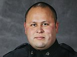 """This undated photo provided by the Tacoma Police Department shows officer Reginald """"Jake"""" Gutierrez, who was shot and killed while responding to a domestic violence call Wednesday, Nov. 30, 2016, in Tacoma, Wash.  Gutierrez, had served with the department since 1999 and was highly respected and experienced, Tacoma Police Chief Donald Ramsdell said Thursday, Dec. 1, 2016. (Tacoma Police Department via AP)"""
