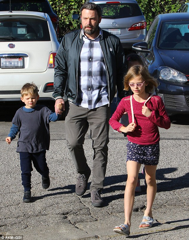 Devoted father:The bearded actor, who stepped out in suede tennis shoes, kept a close eye on his kids as they headed inside; Samuel (l) with Violet (r) and Seraphina walking behind her