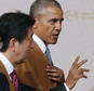 FILE - In this Nov. 20, 2016 file photo, U.S. President Barack Obama, right, talks with Japan's Prime Minister Shinzo Abe after they joined leaders of the Asia-Pacific Economic Cooperation (APEC) for a group photo in Lima, Peru. Abe said Monday, Dec. 5, he will visit Pearl Harbor with Obama at the end of this month, becoming the first leader of his country to go to the U.S. Naval base in Hawaii that Japan attacked in 1941, propelling the United States into World War II. (AP Photo/Pablo Martinez Monsivais, File)