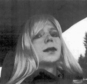 FILE - In this undated file photo provided by the U.S. Army, Pfc. Chelsea Manning poses for a photo wearing a wig and lipstick. A military prison psychologist is refusing to recommend that Manning?s gender be officially changed to female on her Army employee-benefits file. Lawyers for the transgender solider imprisoned for leaking classified information made the assertion in a federal court filing Monday, Dec. 5, 2016, in Washington. (U.S. Army via AP, File)