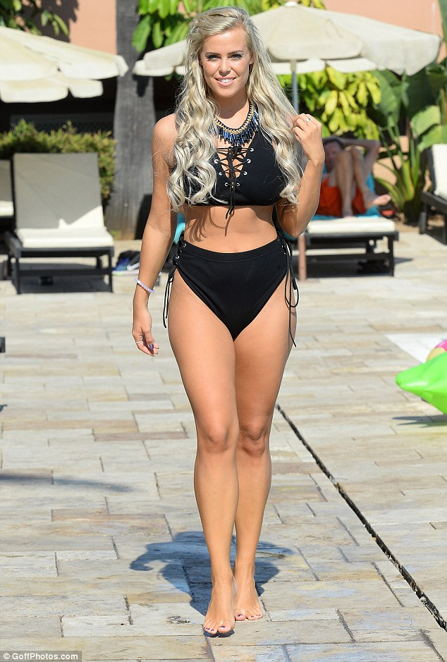 Sizzling in the sun: Slipping into a figure-flaunting selection of swimwear, the two Essex girls ensured their slender curves and gym-honed figures were firmly on display