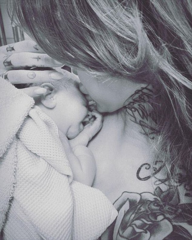 Hold me close: Sallie's Instagram is littered with snaps of her adorable tots
