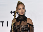 FILE - In this Oct. 15, 2016, file photo, singer Beyonce Knowles attends the Tidal X: 1015 benefit concert in New York. Beyonce set a record for earning Grammy nominations, announced Tuesday, Dec. 6, in the rock, pop, R&B and rap categories in the same year with her diverse album, ¿Lemonade.¿ Only two other acts have earned nominations in those same four categories, Paul McCartney and Janet Jackson, but never in the same year. (Photo by Evan Agostini/Invision/AP, File)