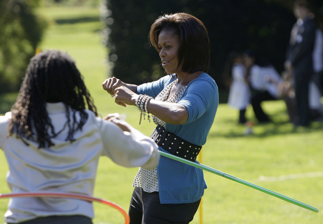 Experts say the first lady is likely to continue her charity work and write a memoir. Mrs Obama is pictured above in 2009, hula hooping with children on the South Lawn of the White Hosue
