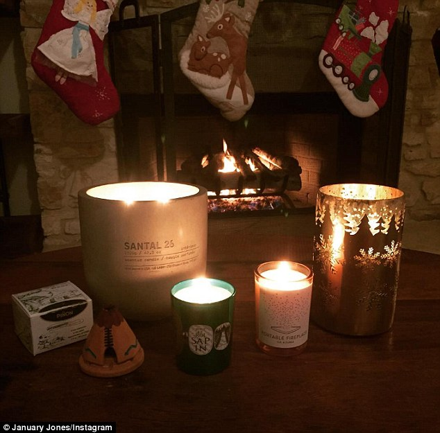 Yuletide spirit: Jones shared an Instagram post of scented Christmastime candles she's amassed