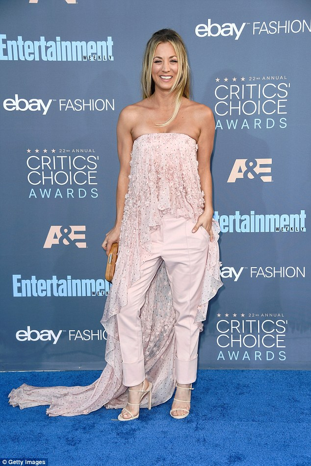 In her strides: The Big Bang Theory star - whose divorce from Ryan Sweeting was finalized in May - chose to shun a more traditional gown in favour of trousers