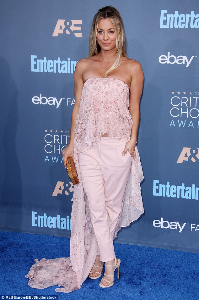 Pretty in pink: She showed off her shoulders in a matching lace bardot top, with waterfall asymmetric hem