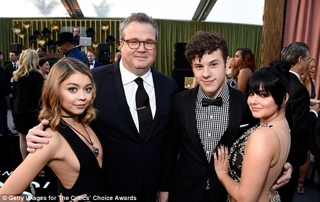 Critically acclaimed: Winter cosied up with co-stars Sarah Hyland, Eric Stonestreet and Nolan Gould as they arrived to support their hit show