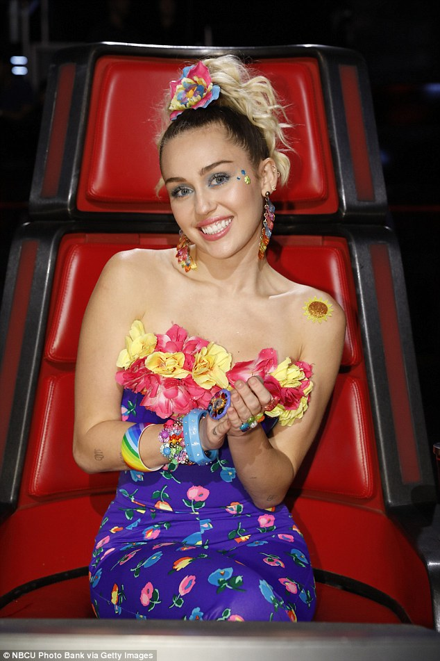 Meanwhile: There was no sign at the game of  Miley Cyrus, who is currently a judge on The Voice