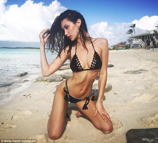 Smoking hot: Bella Hadid turned up the heat in a black bikini during a Bahamas getaway on Sunday