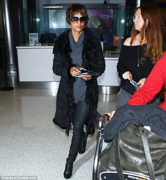 Homeward bound: On Sunday, Halle Berry arrived back stateside after a brief trip to London that she'd begun on Thursday