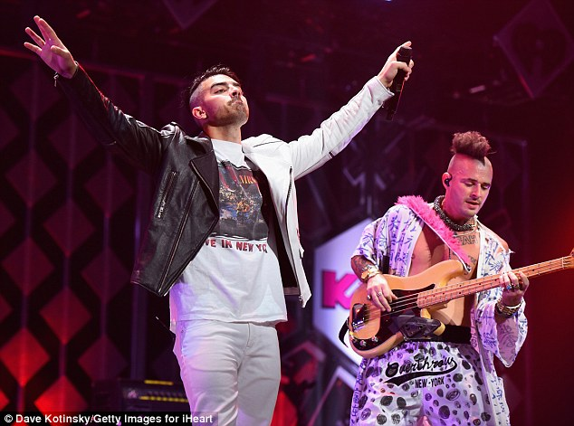 Head-to-toe b&w: The 27-year-old frontman later donned a two-tone motorcycle jacket to sing his track Body Moves