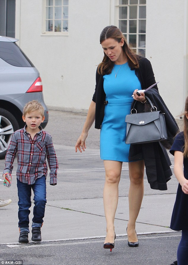Rounding out the bunch: Their three-year-old son and youngest child Samuel had also accompanied his mother to church